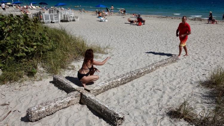 A huge, wooden cross washed up on the beach in Fort Lauderdale