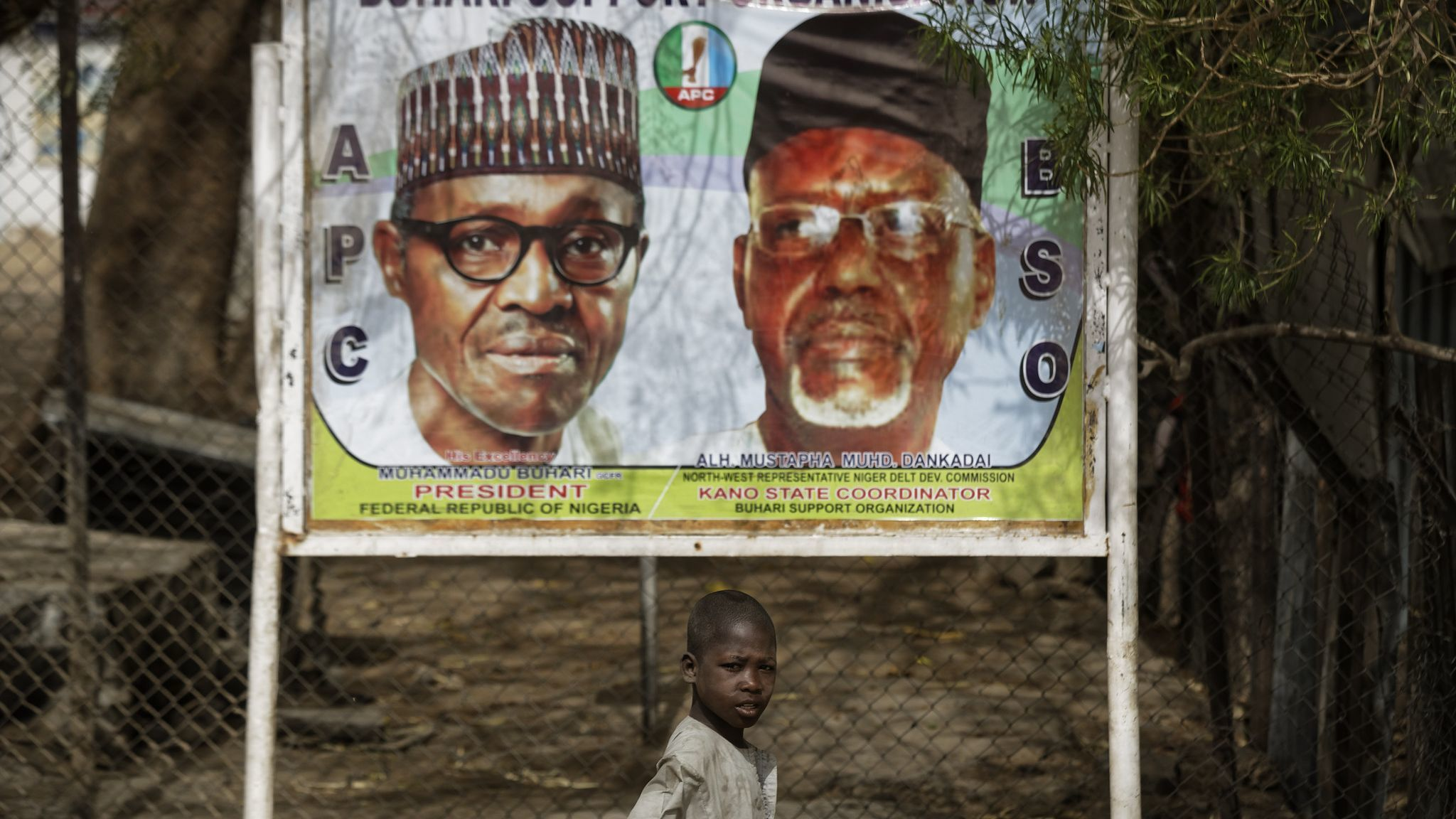 Hours before polls were to open, Nigeria delays election a week, citing 'challenges'