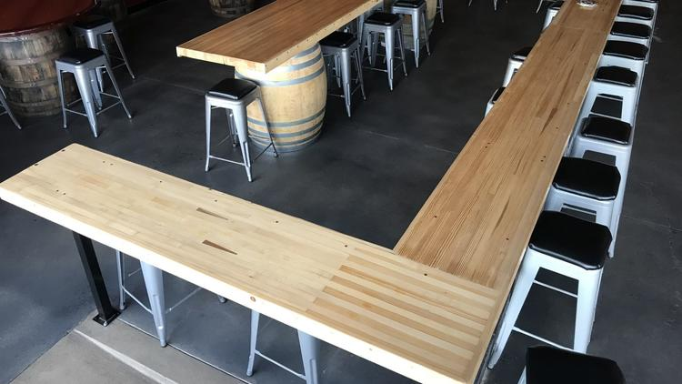 This bar counter at Hoppy Daze brewpub in Otay Mesa West was constructed from upcycled bowling alley lanes from the former Vista Entertainment Center,