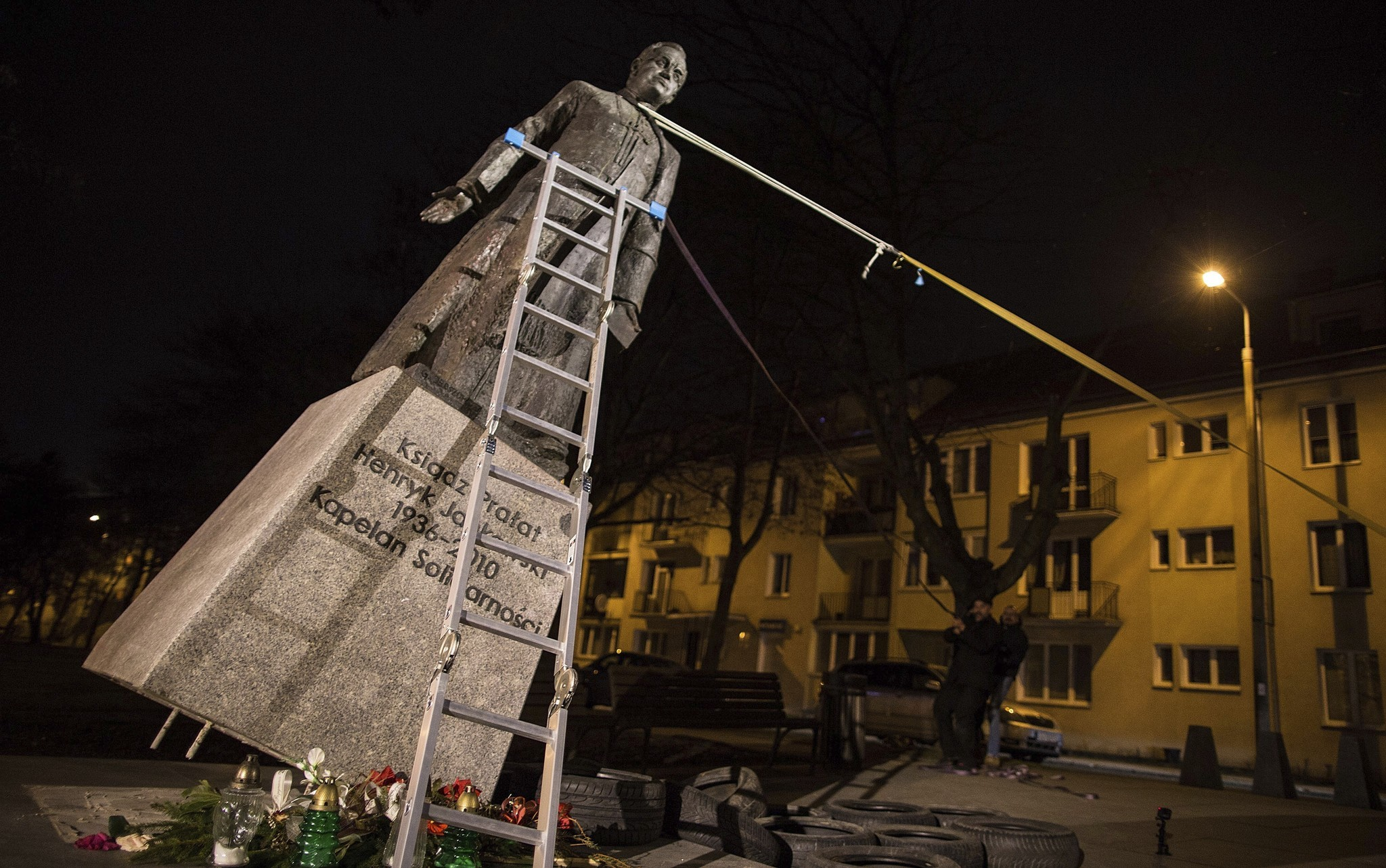 Activists topple statue of prominent Polish priest in abuse protest