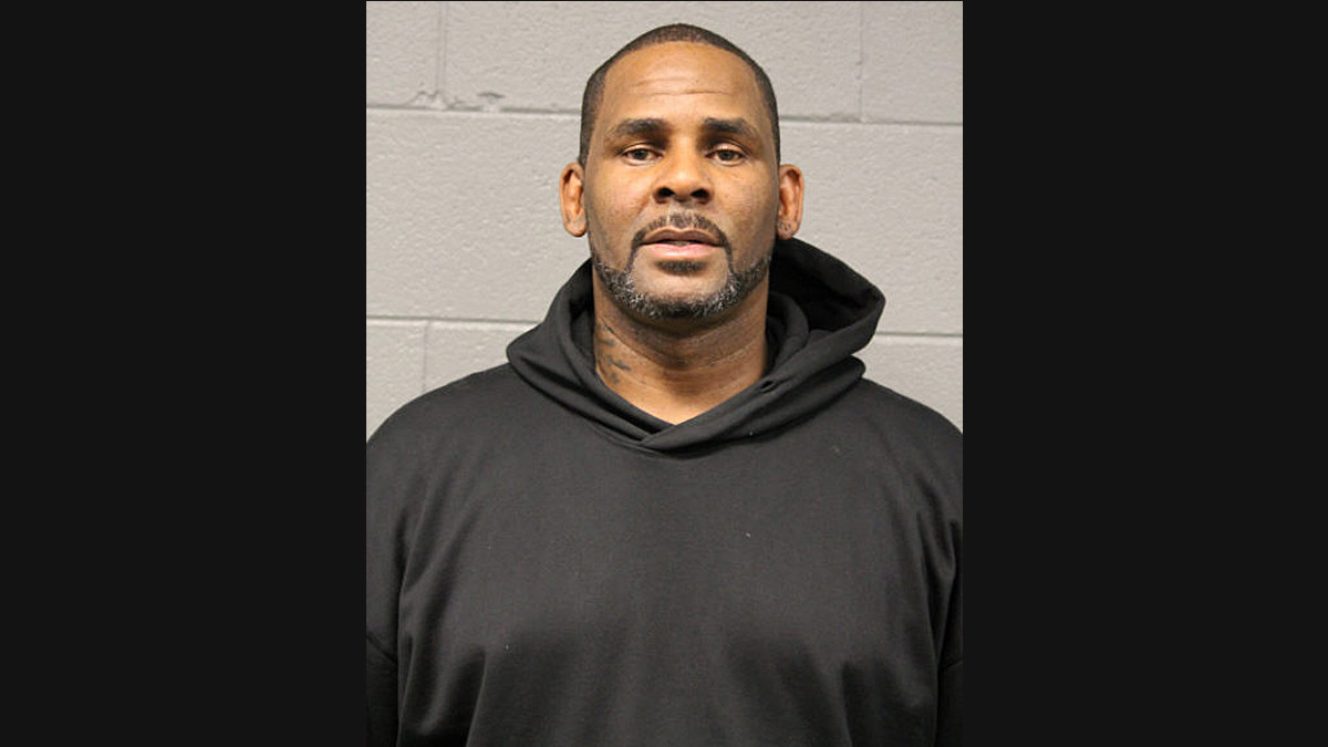 R. Kelly surrenders to Chicago police after being charged with sexually abusing 4 alleged victims