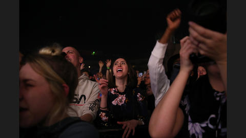 Fans sing to the music of pop singer Robyn at Aragon Ballroom.