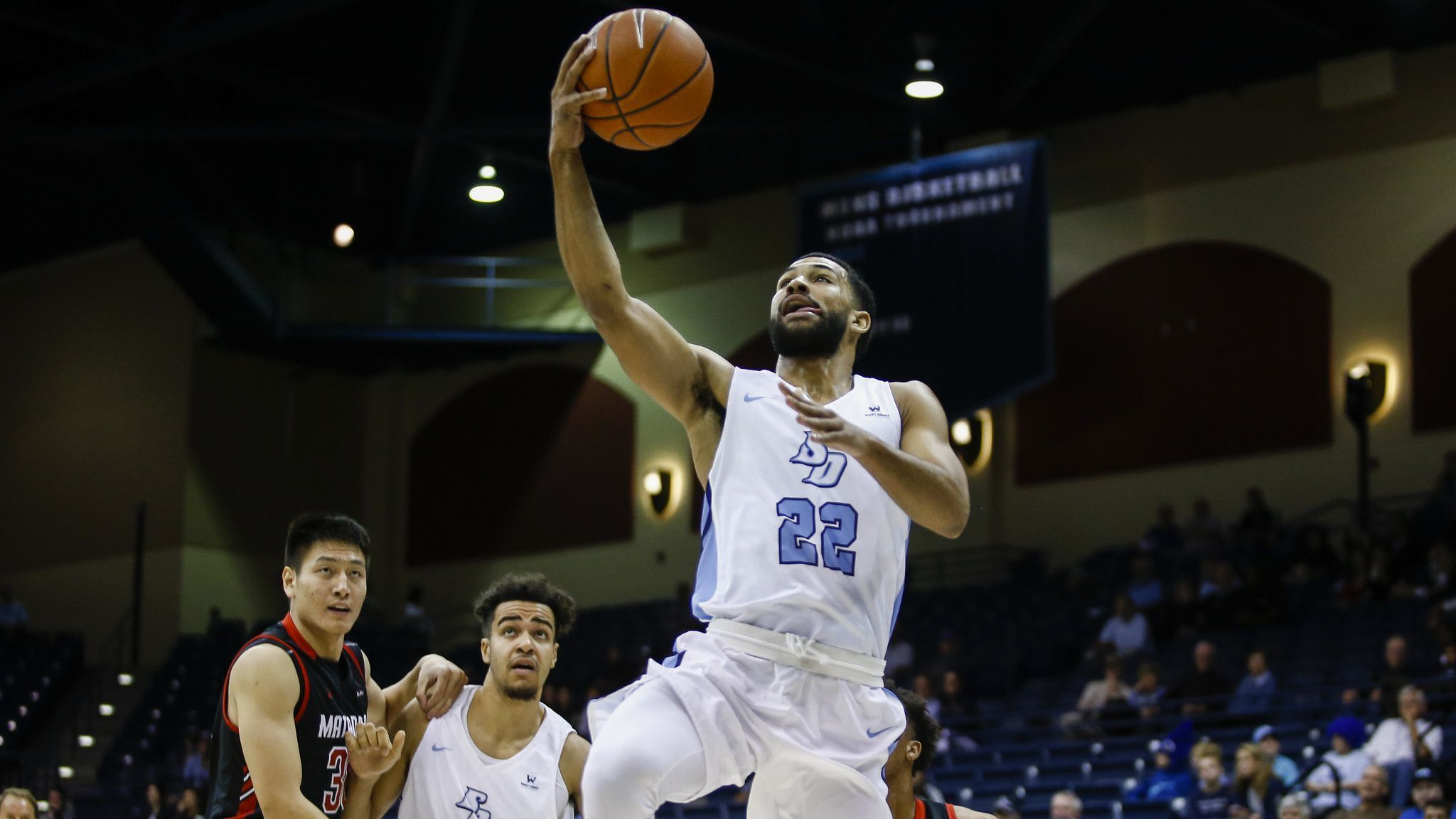 USD wins with defense, stays alive in WCC