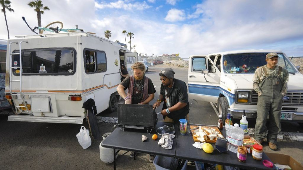 Living on a pennies with a million dollar view: how car campers survive in beach parking lots