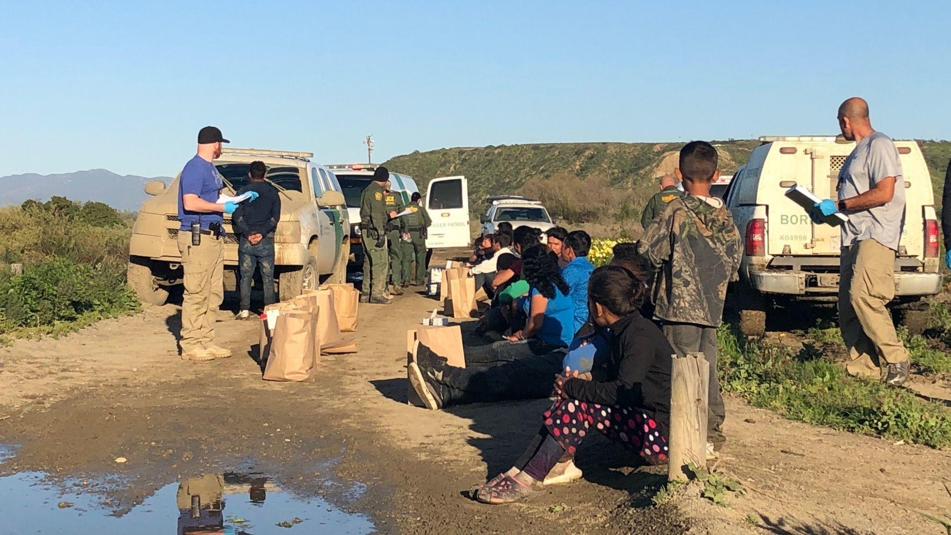 Dozens of migrants breach border fence at Pacific Ocean