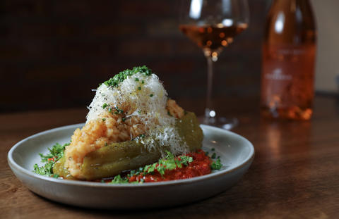 The stuffed pepper is filled with Acquerello rice and topped with Parmesan, surrounded by tomato sauce — an odd sort of stuffed-pepper-meets-risotto mashup.