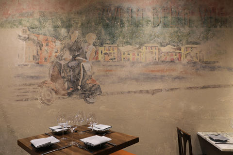 A faded looking mural at Joe's Imports restaurant adds a bit of an Old World interest to the narrow dining room.