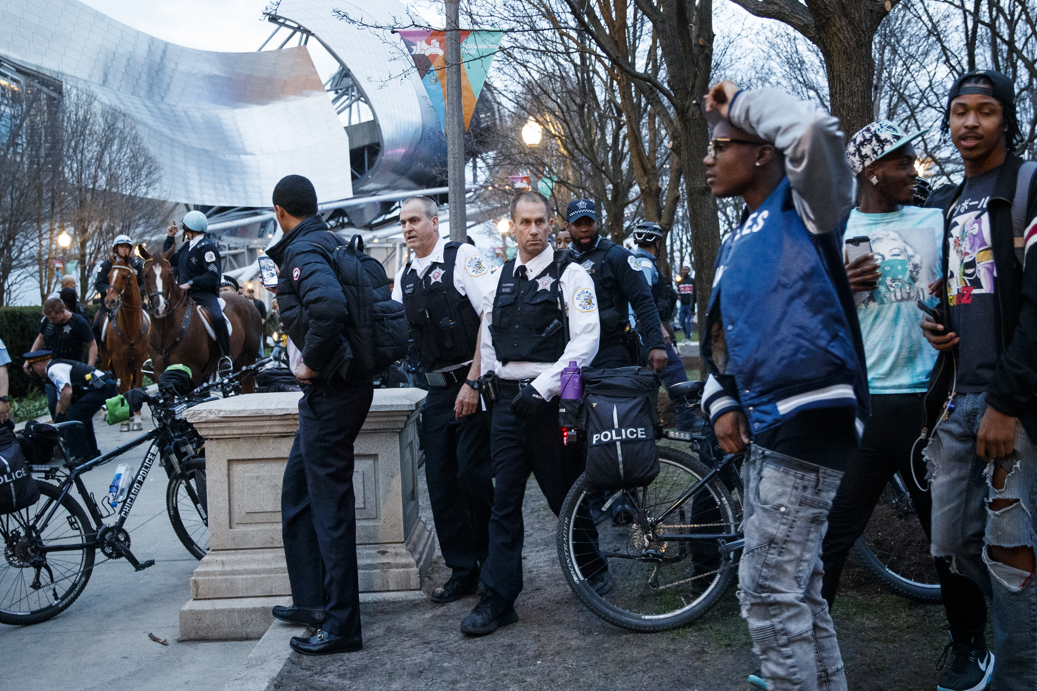 Nearly 30 arrested when fights break out as hundreds of young people descend on downtown Chicago