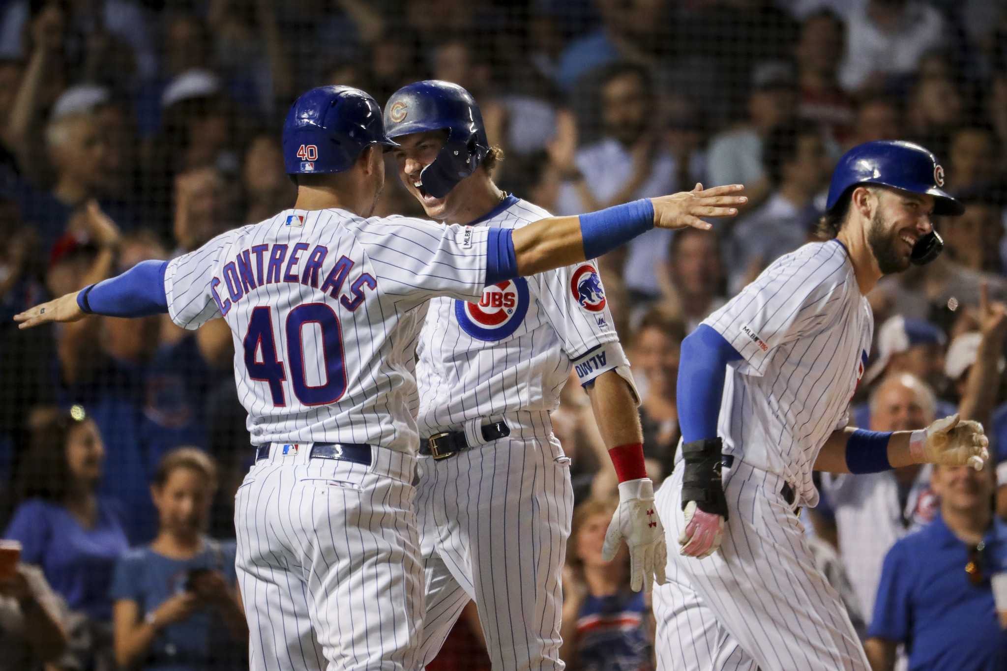 Albert Almora's grand slam and homers by Anthony Rizzo and Javier Baez vault the Cubs to an 8-4 win over the Phillies