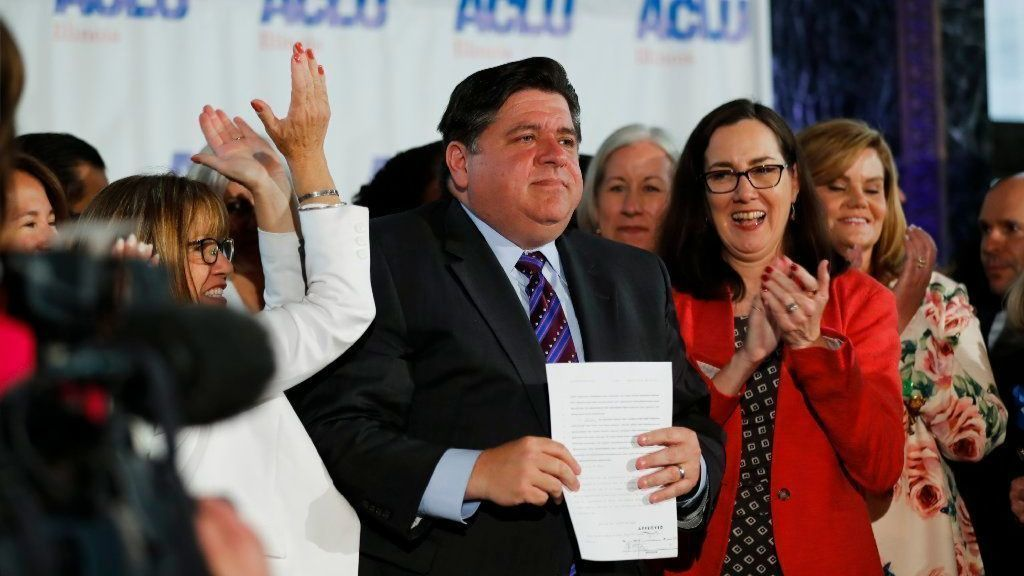 Gov. J.B. Pritzker cheered as he signs abortion bill, but what is the cost?