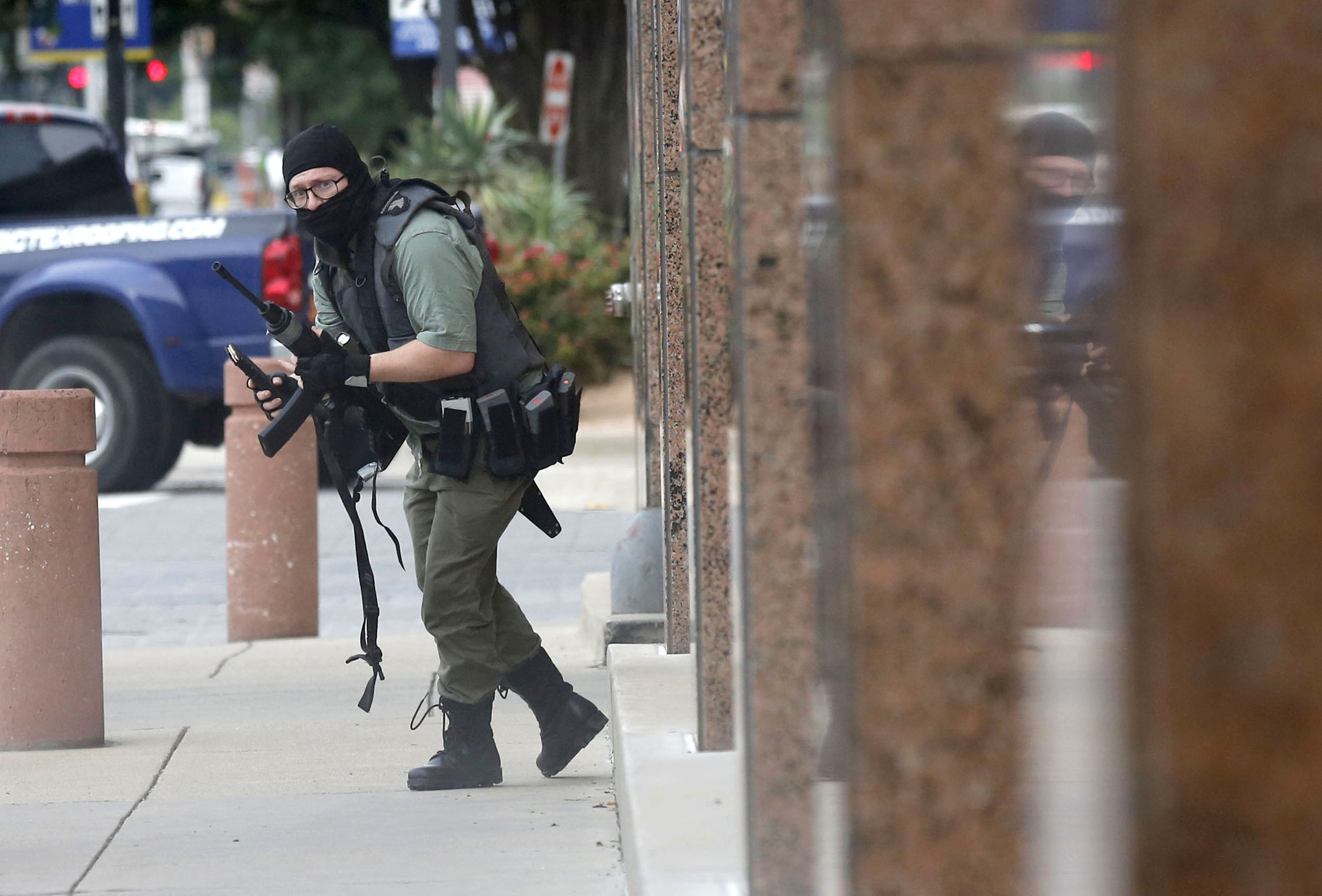 Masked gunman carrying high-powered rifle killed in exchange of gunfire with officers outside Dallas courthouse