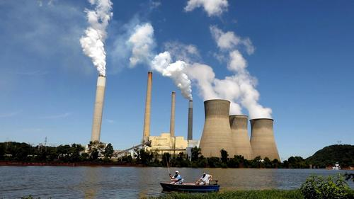 Trump moves to gut Obama climate policy and bolster the coal industry