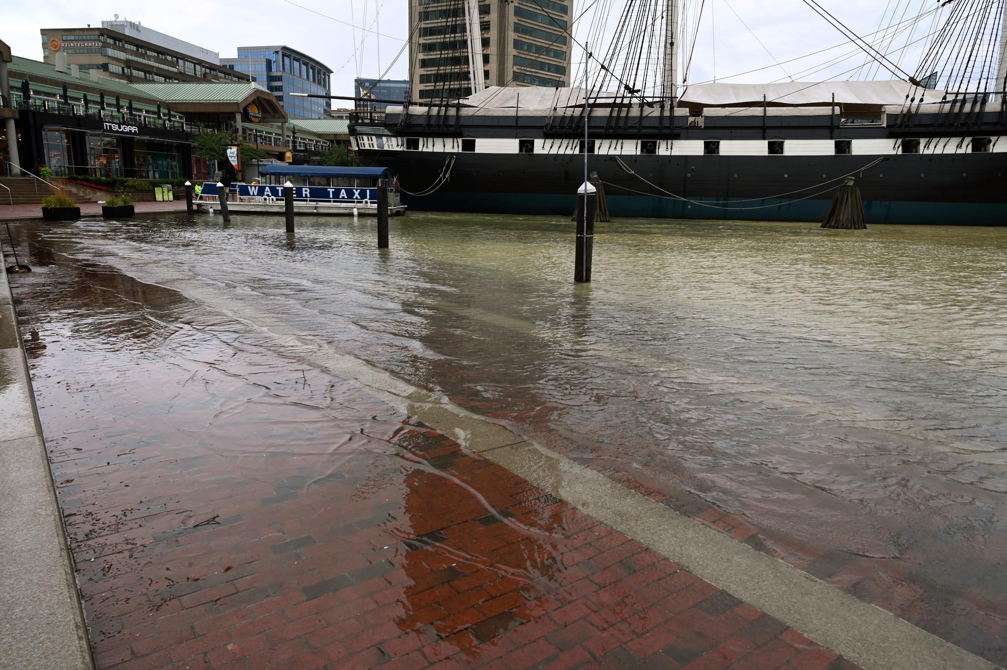 Water main break floods Inner Harbor, causes train derailment; worker injured in nearby storm drain