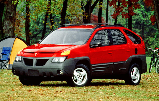 Drive one and you quickly realize that the Aztek's exterior design is its best feature. It's the very worst car of all time because it's the only car on the list to kill an 84-year-old car company. It's undeniable that the Aztek's utter hideousness drove the biggest and last nails into Pontiac's heavily side-clad, plastic coffin.