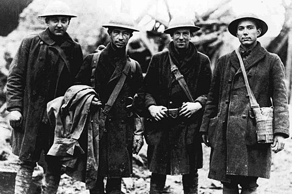World War I  ended on Nov. 11, 1918 with Germany's signing of the Armistice. The U.S. began honoring its military veterans the following year when President Woodrow Wilson declared the day a holiday.  Above, U.S. soldiers in the 315th Infantry pose for a photo in France in November 1918.