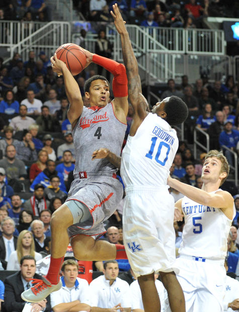Seth Allen looks to pass while being defended by Kentucky's Archie Goodwin.