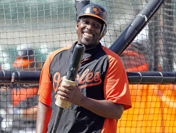 Designated hitter Vladimir Guerrero of the Baltimore Orioles smiles during batting practice.