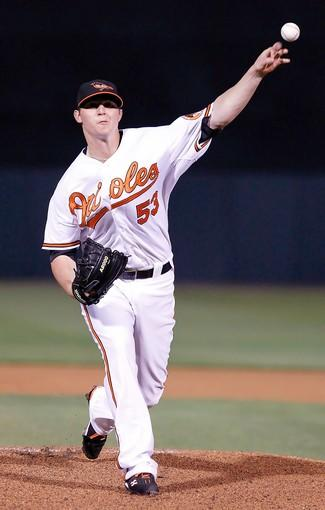 Orioles pitcher Zach Britton delivers against the Yankees. Britton threw three shutout innings in the scoreless tie.