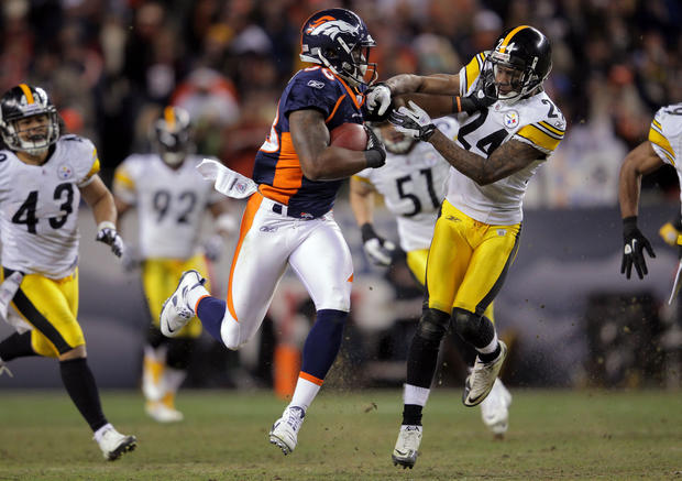The Broncos' Demaryius Thomas (left) stiff-arms the Steelers' Ike Taylor en route to an 80-yard touchdown from Tim Tebow on the first play of overtime. Denver won, 29-23, and advances to face top-seeded New England in the divisional round of the NFL playoffs.
