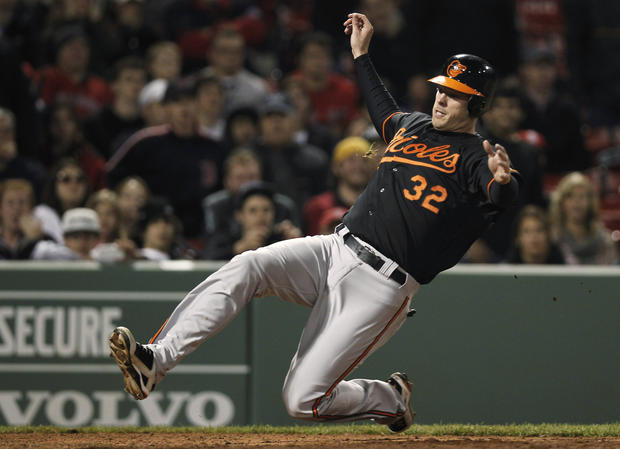 Matt Wieters scores the winning run on a hit by teammate Chris Davis in the 13th inning of the Orioles' 6-4 win over the Red Sox.