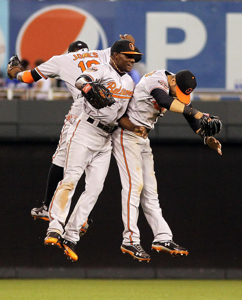 From left, Orioles outfielders Adam Jones, Xavier Avery and Nick Markakis celebrate their 4-3, 15-inning win over the Royals.