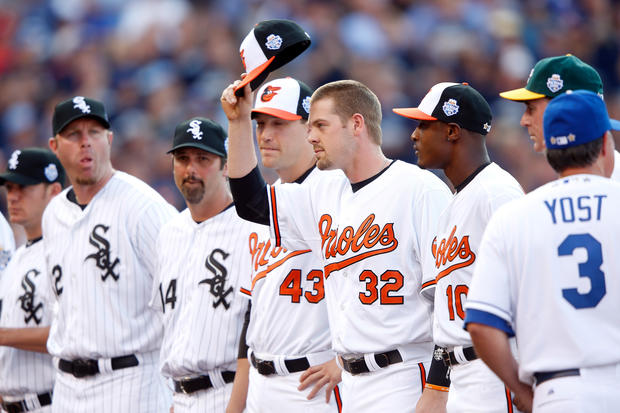 Matt Wieters tips his cap during player introductions for the 2012 All-Star Game at Kauffman Stadium. He's flanked by teammates Jim Johnson and Adam Jones.