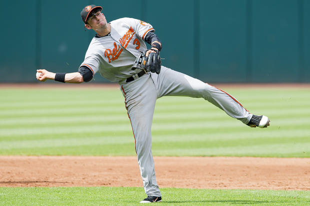 Orioles second baseman Ryan Flaherty tries but can't throw out Cleveland's Carlos Santana on an infield single in the second inning Sunday.