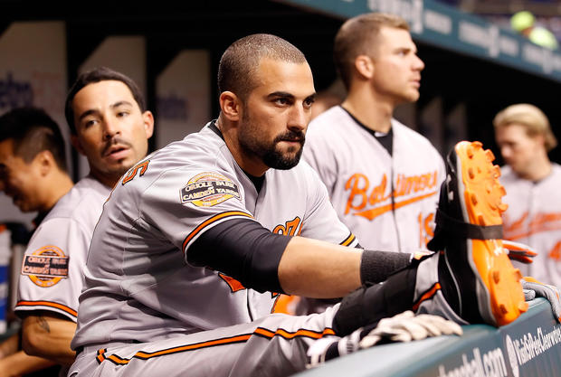 Orioles outfielder Nick Markakis stretches during the game against the Tampa Bay Rays.