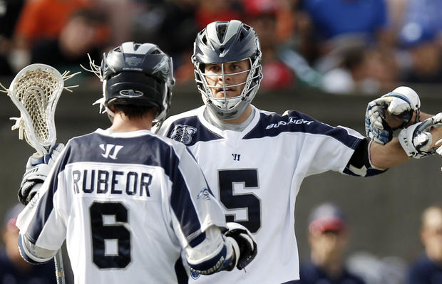 The Bayhawks' Kyle Dixon, right, celebrates his goal with Ben Rubeor during the MLL semifinal against the Boston Cannons.