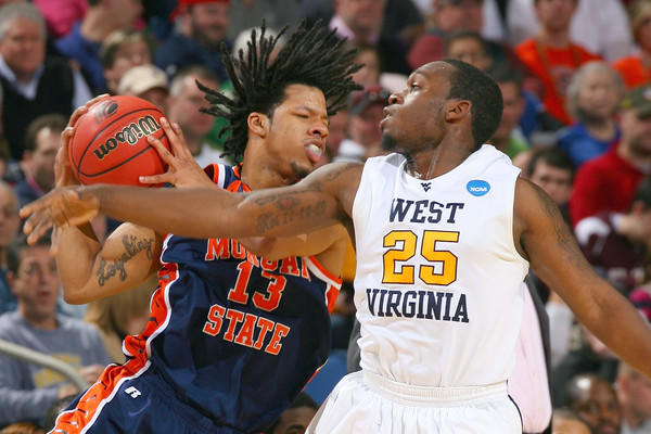 West Virginia's Darryl Bryant (right) defends against Morgan State's Sean Thomas during the Bears' 77-50 loss in the first round of the NCAA tournament.