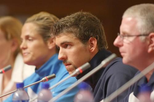 Michael Phelps, center, coach Bob Bowman, right, and Dara Torres of the United States swimming team field questions at a news conference before the beginning of the 2008 Olympics in Beijing.