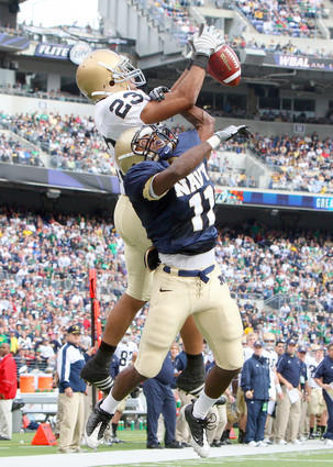 Navy cornerback Ketric Buffin (11) breaks up a pass intended for Notre Dame's Golden Tate in the end zone.