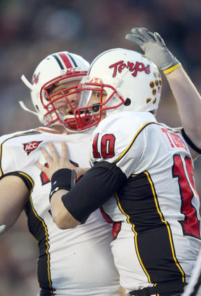 Terps quarterback Chris Turner (right) celebrates with fullback Cory Jackson after rushing for a touchdown in the first quarter against Boston College at Alumni Stadium.