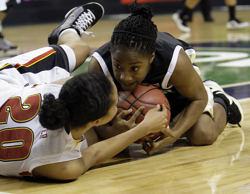 Terps guard Kristi Toliver (left), who was named ACC Player of the Year, wrestles for possession with Wake Forest's Brooke Thomas during the second half. Toliver scored 15 points in the Terps' 72-70 victory.