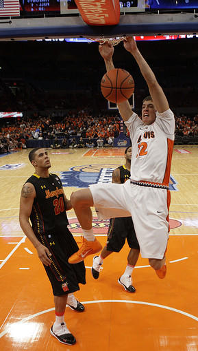 Illinois center Meyers Leonard, right, dunks as Maryland's Jordan Williams looks on during the No. 13 Illini's 80-76 win at Madison Square Garden.