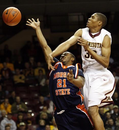 Minnesota's Rodney Williams blocks a shot by Morgan State's Joe Davis in the first half.