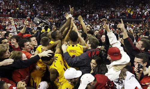Maryland players and fans celebrate the Terps' 88-85 overtime victory over No. 3 North Carolina on the Comcast Center court.