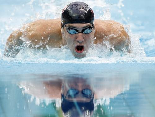 Michael Phelps swims to his sixth gold medal and sixth world record of the Beijing Olympics, cruising to victory by more than two seconds in the 200-meter individual medley.