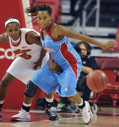 Marah Strickland (left) and Delaware State's Samantha Koonce go for a loose ball in the second half.