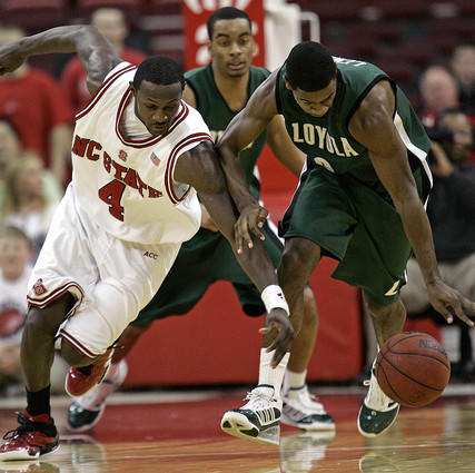 North Carolina State's Courtney Fells battles Loyola's Tony Lewis a loose ball during the second half.