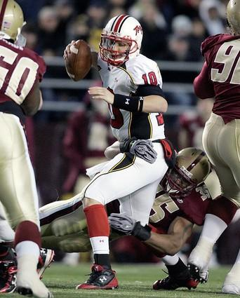 Boston College linebacker Robert Francois (bottom) sacks Terps quarterback Chris Turner in the second quarter.