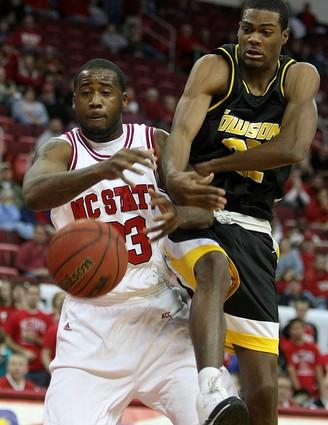 North Carolina State's Tracy Smith (23) fights for a rebound with Towson's Jarrel Smith during the first half.