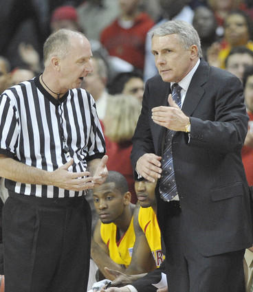 Gary Williams talks with one of the referees during a break in the action in the Terps' loss to Wake Forest.