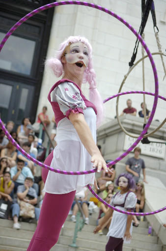 Kelly Jo Stall, an aerial dancer, performs at the Street Theatre Stage at Artscape.