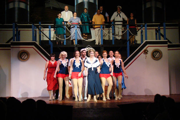 "From left, Emily Sergo (Erma), Hannah Thornhill (Angel), Carlie Kidd (Angel), Nicole Anderson (Reno Sweeney), Amanda Cimaglia (Angel) and Lacy Schmidt (Angel) perform in AGST's production of ""Anything Goes."""