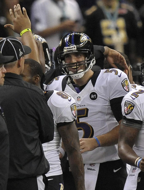 Joe Flacco celebrates on the sideline after throwing a touchdown pass to Jacoby Jones.