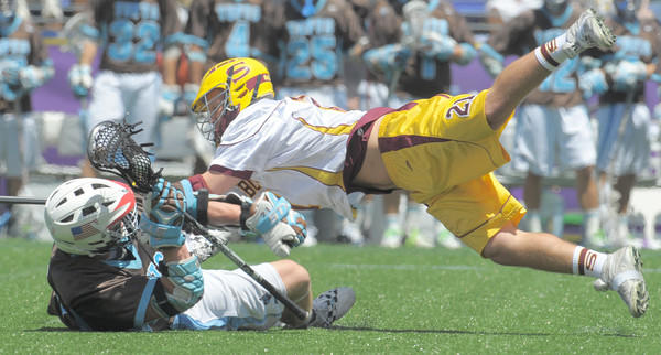 Salisbury's Evan Hockel dives after the ball and Tufts middie, Nick Rhoads during Saturday afternoon's Division III championship game won by Tufts 9-6 over the Sea Gulls and played at M&T Bank Stadium in Baltimore.