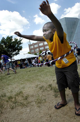 Quantrell Sheddrick, 9, of Baltimore, takes a try at one of the smaller hula hoops placed out for use by festival patrons.