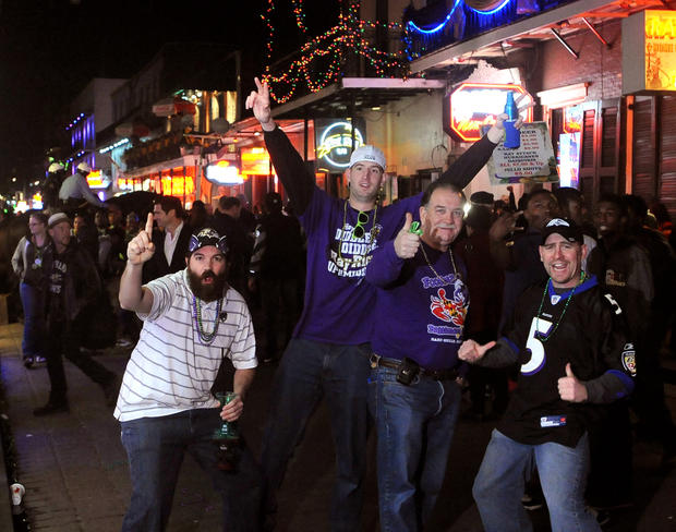 Ravens fans pose for the camera on Bourbon Street in New Orleans as they party two days before Super Bowl XLVII.