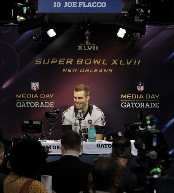 Joe Flacco answers questions during Super Bowl Media Day.